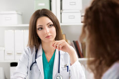 Young attentive doctor consulting patient Stock Images