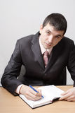 Young attentive man with organizer Royalty Free Stock Photos