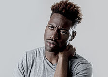 Young attractive afro american black man in sad and tired face expression looking exhausted. And worried isolated on grey background in depression and sadness royalty free stock images