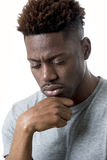 Young attractive afro american man on his 20s looking sad and depressed posing emotional Royalty Free Stock Photo