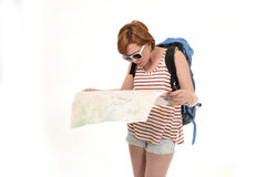 Young attractive American tourist woman with red hair holding city map carrying backpack lost and confused Royalty Free Stock Images