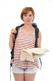 Young attractive American tourist woman with red hair holding city map carrying backpacker rucksack Stock Images