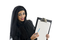 Young attractive arabic business woman showing clipboard. Isolated on white background Royalty Free Stock Photography