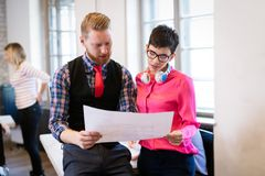 Young attractive architects discussing in modern office Stock Images