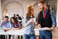Young attractive architects discussing in modern office Royalty Free Stock Photo