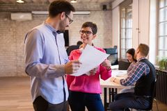Young attractive architects discussing in modern office stock photos