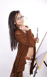 Young attractive artist girl. Young beautiful artist girl holding a paint brushes and smiling Stock Photos