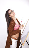 Young attractive artist girl. Young beautiful artist girl holding a paint brushes and smiling Stock Images
