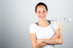 Young attractive artist woman using brushes to paint Stock Photography