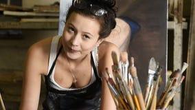 Young attractive artist working in art studio stock footage