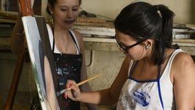 Young attractive artist working in art studio stock video