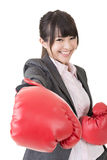Young attractive asian business woman with red boxing gloves are Stock Photos