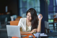 Young attractive Asian business woman sleeping, drowsing or taki. Ng a nap at her desk, Tired business woman accountant with bills and paper folders in office Royalty Free Stock Photos