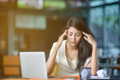 Young attractive Asian business woman sleeping, drowsing or taki. Ng a nap at her desk, Tired business woman accountant with bills and paper folders in office Stock Photos
