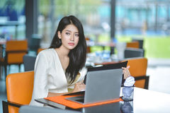 Young attractive Asian business woman sleeping, drowsing or taki. Ng a nap at her desk, Tired business woman accountant with bills and paper folders in office Stock Images
