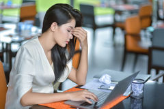 Young attractive Asian business woman sleeping, drowsing or taking a nap at her desk, Tired business woman accountant with bills royalty free stock photos