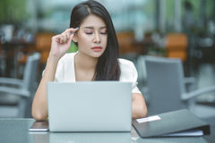 Young attractive Asian business woman sleeping, drowsing or taki. Ng a nap at her desk, Tired business woman accountant with bills and paper folders in office Stock Photo