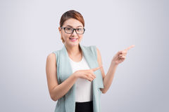 Young attractive asian businesswoman points to the finger on gre Stock Image
