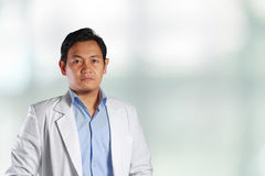 Young Attractive Asian Male Doctor Smiling Stock Photo