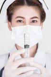 A young attractive asian nurse Royalty Free Stock Photos