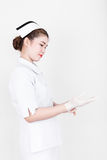 A young attractive asian nurse Stock Photos