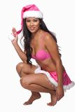 Young attractive asian pacific islander woman. In her twenties wearing pink Santa outfit royalty free stock photo
