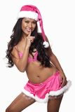 Young attractive asian pacific islander woman. In her twenties wearing pink Santa outfit stock photography