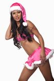 Young attractive asian pacific islander woman. In her twenties wearing pink Santa outfit stock photo