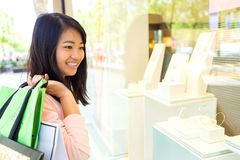 Young attractive asian tourist doing shopping in Paris Royalty Free Stock Images