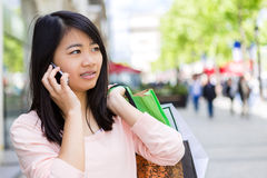 Young attractive asian tourist doing shopping in Paris Royalty Free Stock Photos