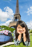 Young attractive asian tourist enjoying her Paris trip Royalty Free Stock Image