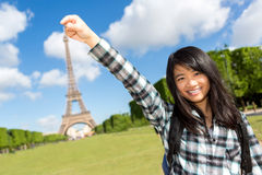 Young attractive asian tourist in front of Eiffel tower Royalty Free Stock Images