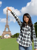 Young attractive asian tourist in front of Eiffel tower. View of a Young attractive asian tourist in front of Eiffel tower Stock Photography
