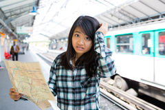 Young attractive asian tourist lost in Paris Stock Images