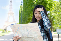 Young attractive asian tourist lost in Paris Royalty Free Stock Photo