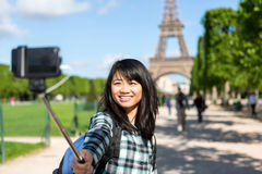 Young attractive asian tourist in Paris taking selfie Stock Photo