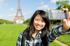 Young attractive asian tourist in Paris taking selfie Royalty Free Stock Images