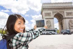 Young attractive asian tourist taking pictures in Paris Stock Photo