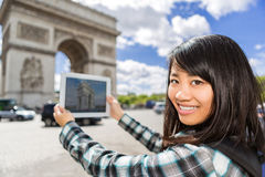 Young attractive asian tourist taking pictures in Paris Royalty Free Stock Image