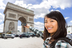 Young attractive asian tourist taking pictures in Paris Stock Images