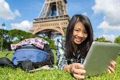 Young attractive asian tourist using tablet in Paris Royalty Free Stock Photography