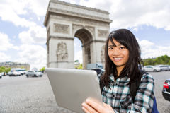 Young attractive asian tourist using tablet in Paris Stock Photo