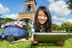 Young attractive asian tourist using tablet in Paris Royalty Free Stock Images