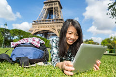 Young attractive asian tourist using tablet in Paris Stock Photography