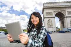 Young attractive asian tourist using tablet in Paris Stock Photos