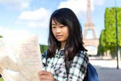 Young attractive asian tourist visiting Paris Royalty Free Stock Images