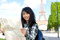 Young attractive asian tourist visiting Paris Royalty Free Stock Image