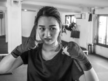 Young attractive asian woman with boxing gloves are ready for battle royalty free stock photos