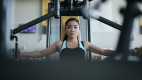 Young attractive asian woman in the gym stock footage
