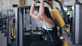 Young attractive asian woman in the gym